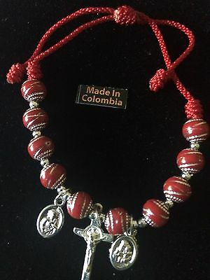 Bracelet With 3 Catholic  Charms Red  String Adjustable Size .