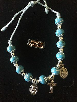 Bracelet With Catholic 3 Charms Light Blue String. Adjustable Size .