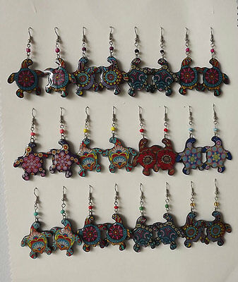 Lot of 12 Pairs of Peruvian Turtle Earrings . Acrylic.