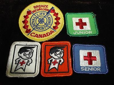 Five Badges: One Royal Life Saving Society And Four Red Cross