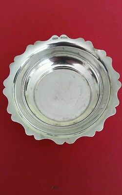 Solid silver scalloped edge bowl.  Made by E J Houlston. Hallmarked 1920
