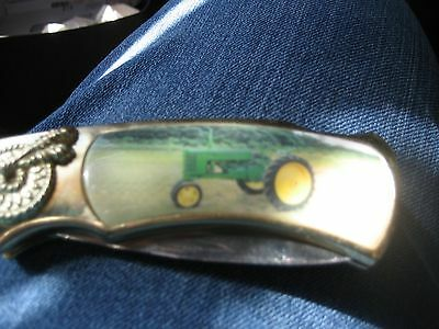 Larger Pocket knife with picture of John Deere tractor on it-blade folds out-