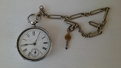 SOLID SILVER Antique key wind Pocket watch good working order with Albert Chain