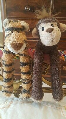 Cuddly small monkey and Tiger