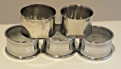 A Set Of 5 Vintage Silver Plated Napkin Rings 2 Plain 3 Patterned