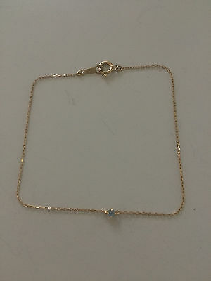 18CT 18K 750 yellow gold fine and delicate ladies bracelet with topaz. Size 17cm