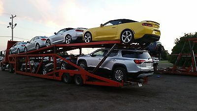 1999 Hide a Bed 6/7 car hauler trailer with 2005 Volvo Semi Tractor