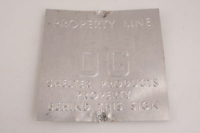 Property Line DG Shelter Products Behind This Small Aluminum Sign V2