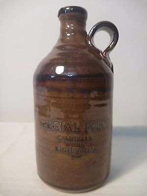 Antique Campbells flagon with finger handle