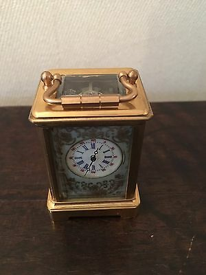 Beautiful Miniture Brass carriage clock with blue porcelain panels