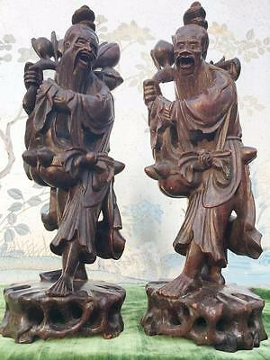 A PAIR OF ANTIQUE CHINESE c.1900 CARVED ROSEWOOD FIGURES OF PEACH SELLERS