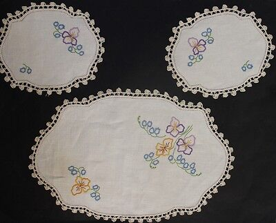 Three vintage beige linen duchess set/doilies with hand embroidered flowers.
