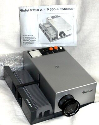 Rolli  AF P30A 35m slide projector with  Auto remote .with book as NEW.