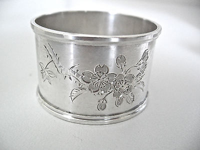 Clean, heavy quality sterling silver napkin ring decorated w/ bright cut flowers