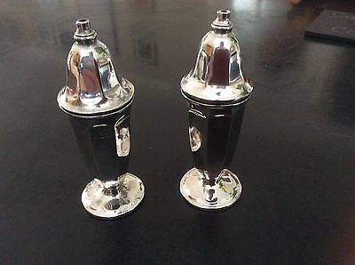 A Pair Of Silver Salts/Shakers Condiments