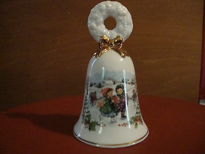 AVON Christmas 1986 Ceramic bell, white/gold, boy/girl ice skating scene. GUC