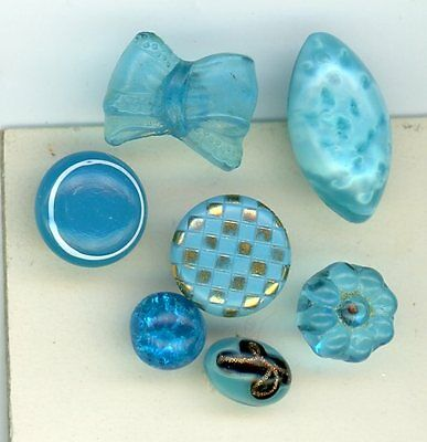 7 aqua glass buttons.  Two are modern, the rest are antique. Swirl back, Overlay