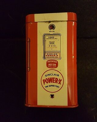 Sinclair Coin Bank, it is red, which is a rare color. Circa 1950's.