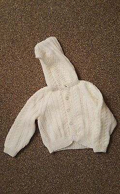 Baby hand knitted hooded cardigan. Brand new.