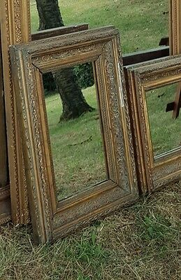 Pair of Small Antique Molded Gilt Mirrors