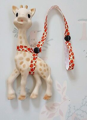 Sophie The Giraffe Harness White Ribbon with Poppy Design & Black Poppers.