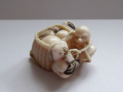 Japanese 19th Century Meiji Period Netsuke, Basket of Clams with Octopus, shells