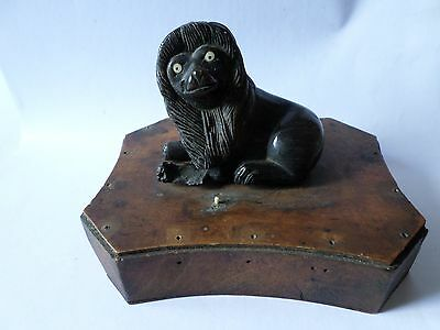 Antique Victorian black dyed bovine lion on wood base desk weight some issues