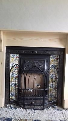 victorian Cast iron Style fireplace.- with original victorian flower tiles.