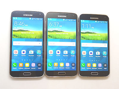 Lot of 3 Samsung Galaxy S5 T-Mobile Smartphones All Power On AS-IS GSM @