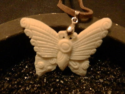 Buffalo bone carving of  a butterfly  925 clam and cord included very detailed