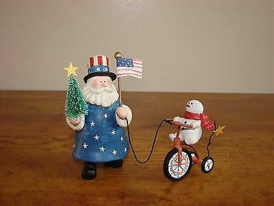 Uncle Sam with Snowman Riding Tricycle-Sandi Gore Evans Figurine