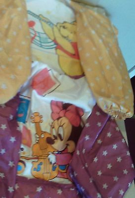 Two Disney long-armed bibs for a baby girl - Winnie the Pooh and Minnie Mouse