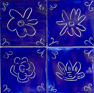 4 flowers, etched into blue,wall tiles,mosaic,blue on white