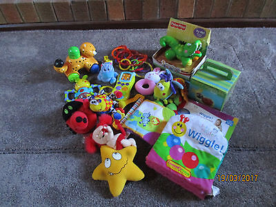 assorted Fisher-Price, playgro and baby einstein toys