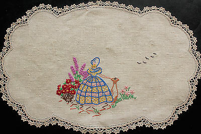 Vintage beige cloth with hand embroidered crinoline lady.