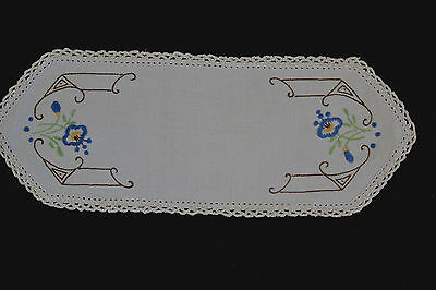 Vintage beige hand embroidered cloth/doily with blue  flowers.