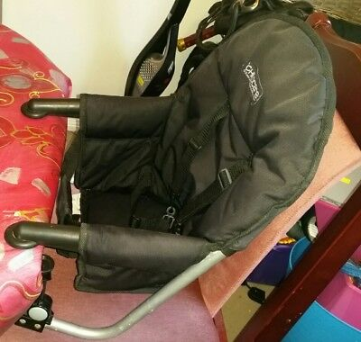 Childcare baby feeding chair.  Portable fold up high chair.  Baby high chair.