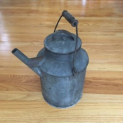Antique/Primitive Galvanized Watering Can with spout marked PMRY/wood handle/rem