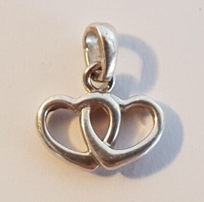 Charming sterling silver conjoined hearts pendant. Metal detecting find