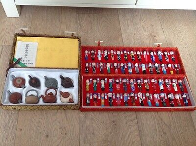 Oriental costume display figures and Oriental mini Clay teapots in cases