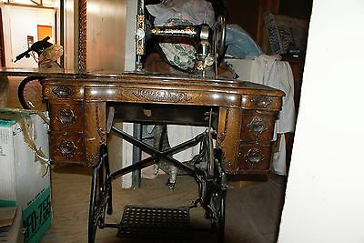 antique foot pedal sewing machine by WHITE with oak cabinet and lots of detail