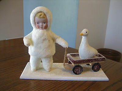 Dept 56 Snow Angels Collection by Elaine Roesle Snow Baby pulling Wagon with Duc