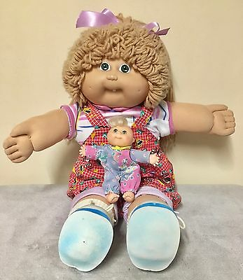 Cabbage Patch Kid Girl Dressed in CPK Outfit with Bonus Mini CPK Doll.