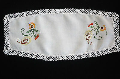 Vintage off-white hand embroidered cloth/doily with orange and red flowers.