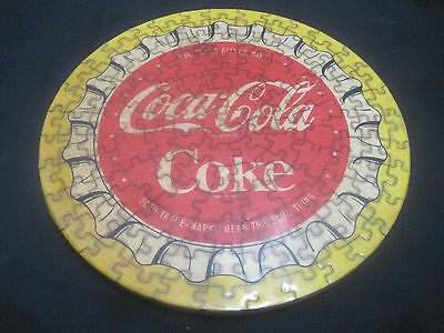 "Vintage 11 1/2"" Lacquered Clear Coat Wood Backing Coca-Cola Puzzle Bottle Cap."