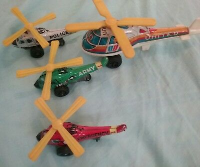 Four Tin Toy Helicopters Made in Japan