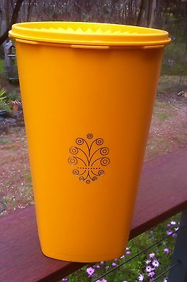 Vintage Retro Orange Large Tupperware canister w/ scroll design. 26.5cm tall.VGC