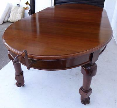Edwardian Two leaf extending Walnut wind out dining table