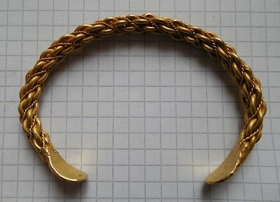 Viking period Gold twisted bracelet with signs