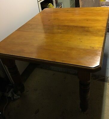 ANTIQUE DINING TABLE WITH EXTENSION LEAF made from Cowrie Pine